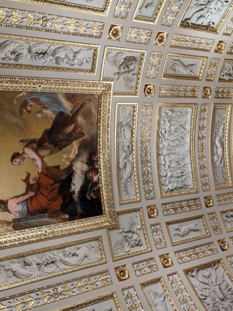 The curved ceiling in the Louvre Museum is painted.