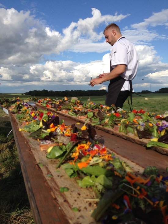 One of  the RGE Rd team prepares the salad course. Photo courtesy of Prairie Garden Farms