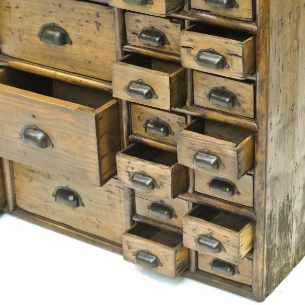 Ancien meuble de métier en bois à tiroirs anciellitude