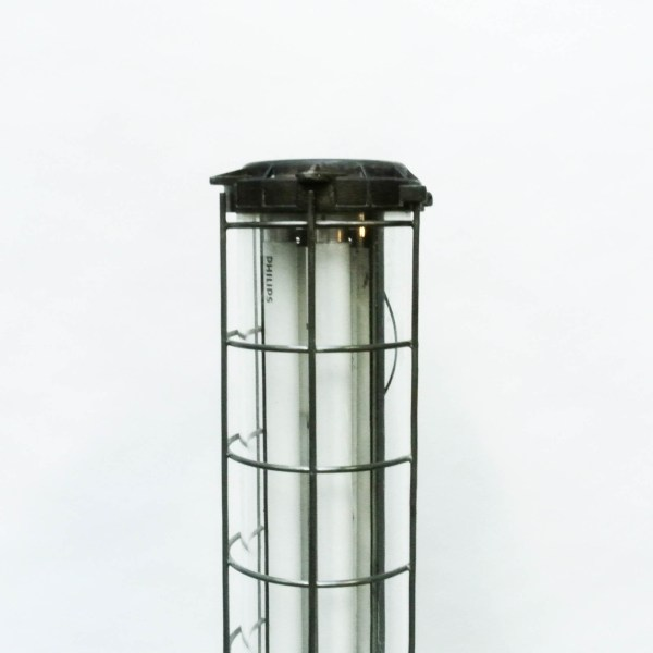 Patinated Industrial Fluorescent Light in Cast Aluminium with a Fence (big size) anciellitude