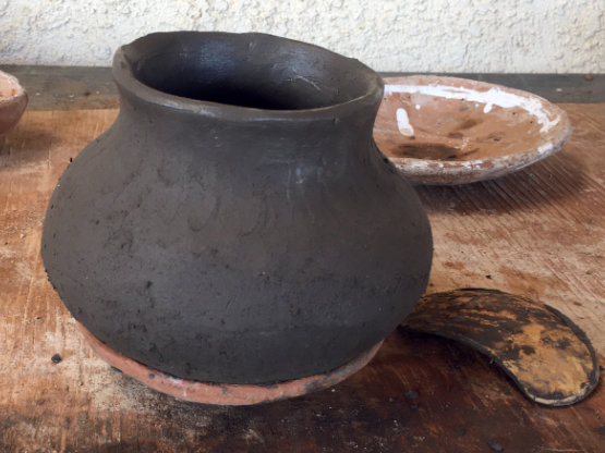 freshly formed pot drying in the puki