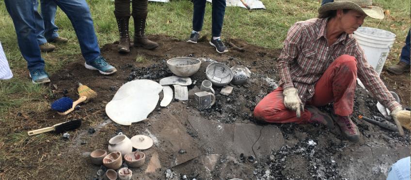 Cherylene Caver unloads a fired traditional Anasazi kiln