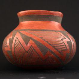 black on red jar