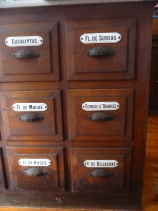 Medicine cabinets. Note the names are in French. Hydra, Greece