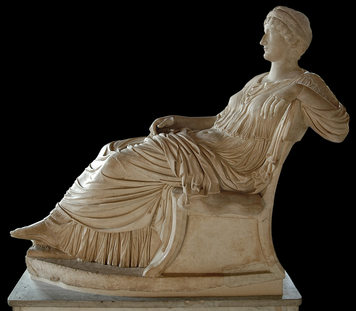 A female sitting statue with portrait head of Helen