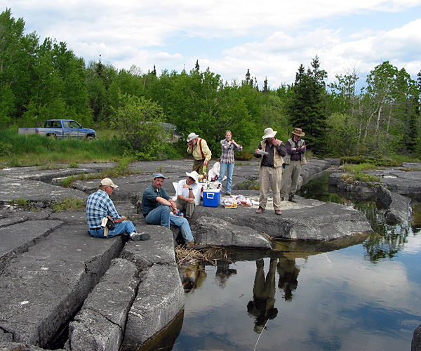 Geological field party eating lunch on the shore of Cormorant Lake (June, 2006)