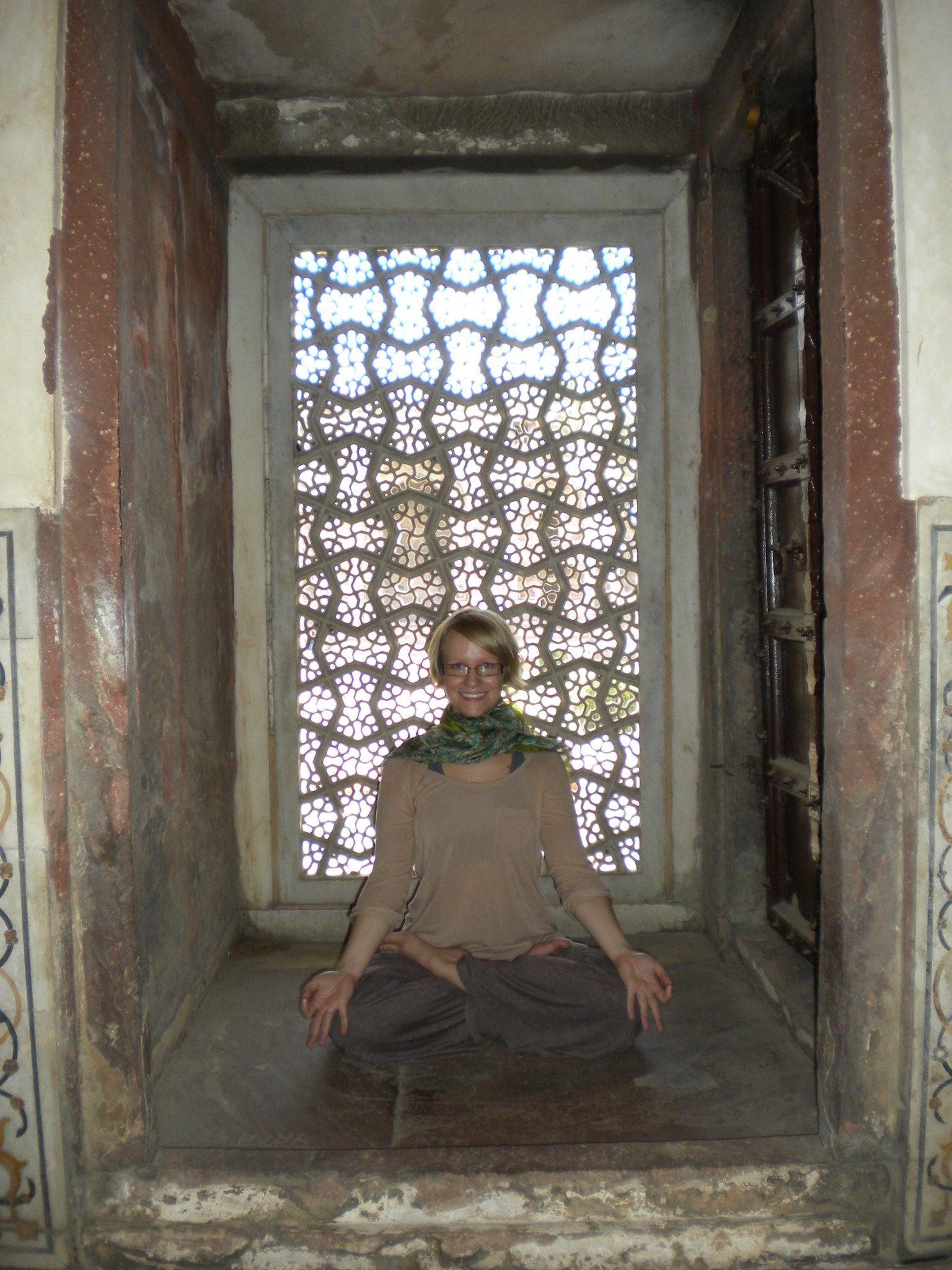 A portrait of Megan in padmāsana / lotus pose