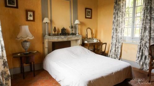 antique-farmhouse-master-bedroom-limestone-flooring