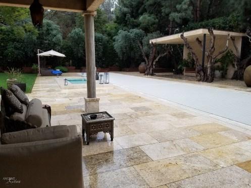 provencal-farmhouse-outdoor-seating-area-limestone-flooring