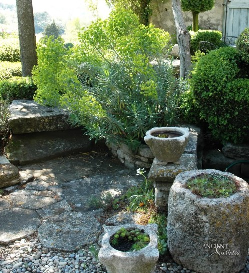 beautiful-french-home-backyard-limestone-troughs-pot
