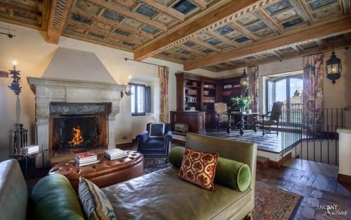 Castello di Santa Eurasia Bedroom with-a-majestic-limestone-fireplace