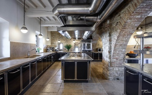 Castello di Santa Eurasia farmhouse-kitchen-style-antique-limestone-flooring