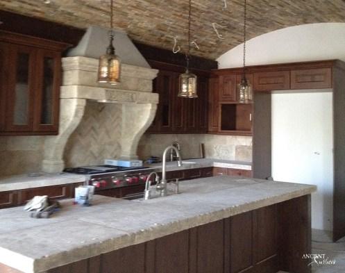 limestone-kitchen-countertop-with-antique-stone-kitchen-hood