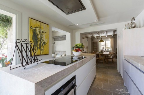 provence-kitchen-with-marble-countertop-and-limestone-flooring