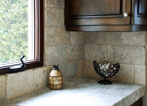 Antique Biblical Stone on Backsplash and Foundation Slabs Butcher Blocks on Counters