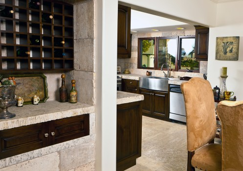 Antique Limestone on kitchen floors walls and wine closet
