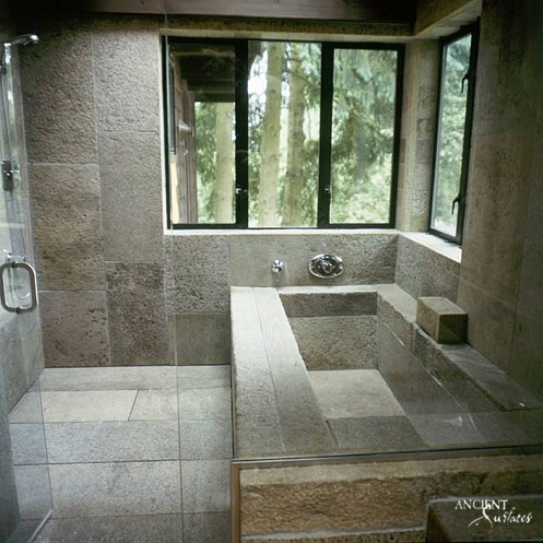 bathroom-limestone-bathtub-with-limestone-flooring