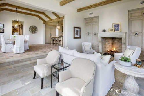 beautiful-spacious-living-room-design-farmhouse-limestone-floorig-wood-beams-and-limestone-antique-fireplace-hand-carved