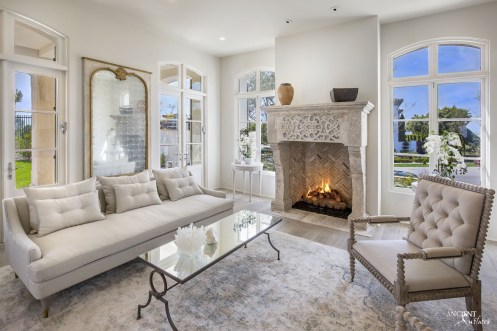 living-room-sitting-area-farmhouse-french-limestone-fireplace-design