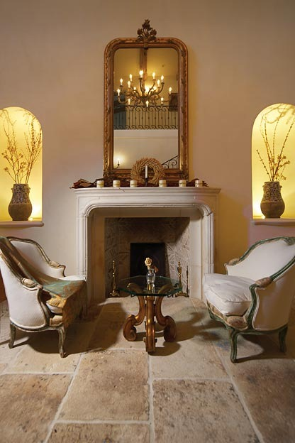 limestone fireplace mantel and limestone flooring