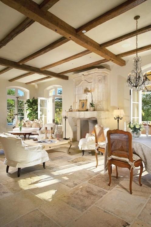 living room design with limestone firepalce design and limestone flooring