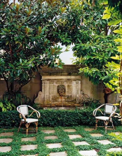 outdoor garden with limestone wall pool fountain