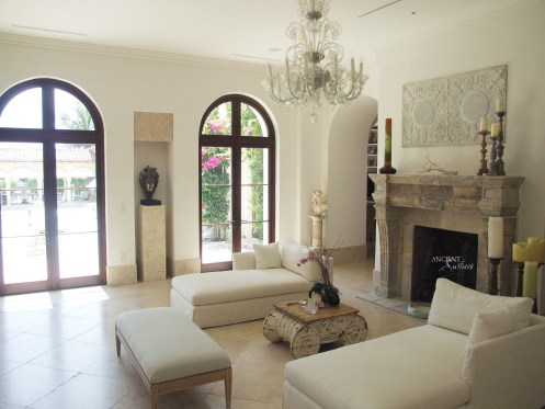 mediterranean-living-room-with-limestone-flooring-stone-biblical-stone-limestone-fireplace-antique