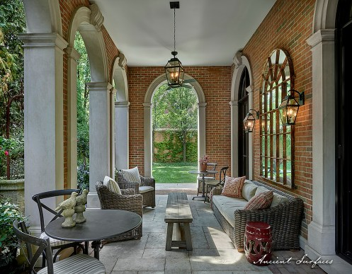 covered-porch-with-limestone-flooring-biblical-stone-floors-and-stone-entryway-columns