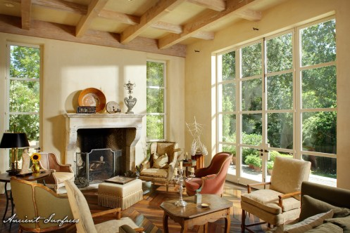 french-farmhouse-ancient-surfaces-beautiful-living-room-area-with-limestone-fireplace-wood-beams