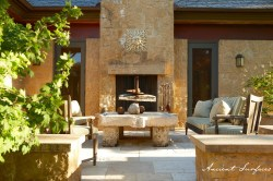 french-farmhouse-ancient-surfaces-outdoor-courtyward-with-limestone-fireplace-seating-area