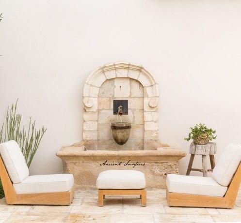 limestone-wall-fountain-outdoor-courtyard