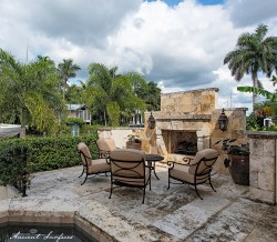 outdoor-courtyard-with-beautiful-old-limestone-fireplace