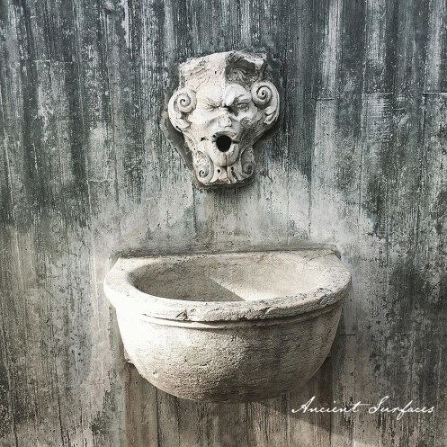 outdoor-limestone-sink-installed-on-wall-with-ha