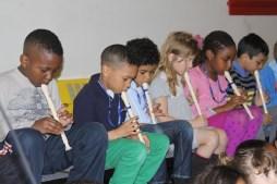 Primary students at the Ancona School playing recorder