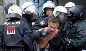 Austrian police officers evict a squatter from an occupied house in the Leopoldstadt area, in Vienna, July 28, 2014.