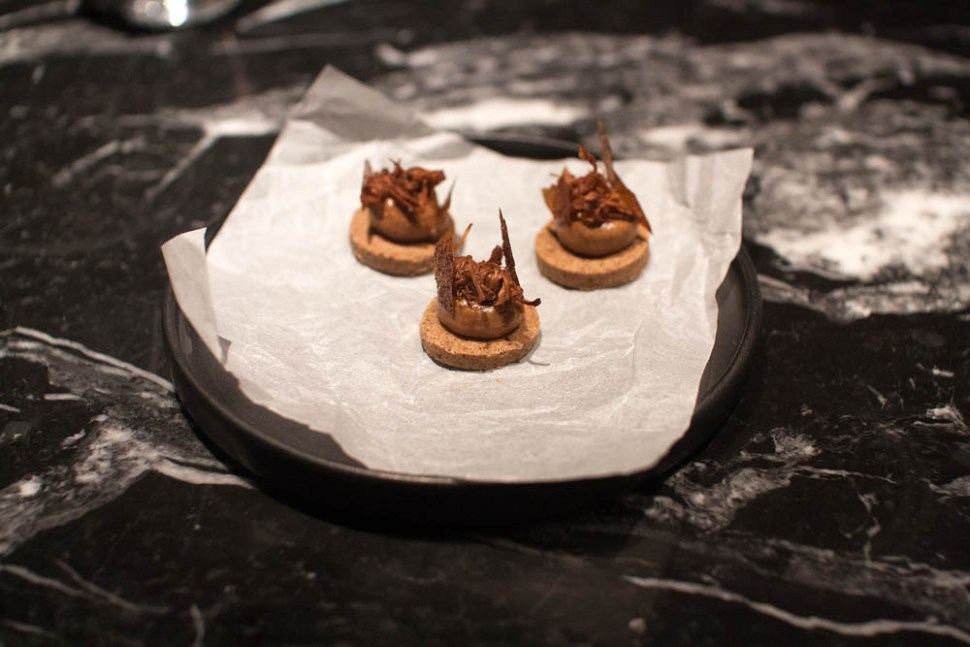 Warm savory cookie made from dried chanterelles, pickled chanterelles, and dehydrated broth from roasted chicken bones.