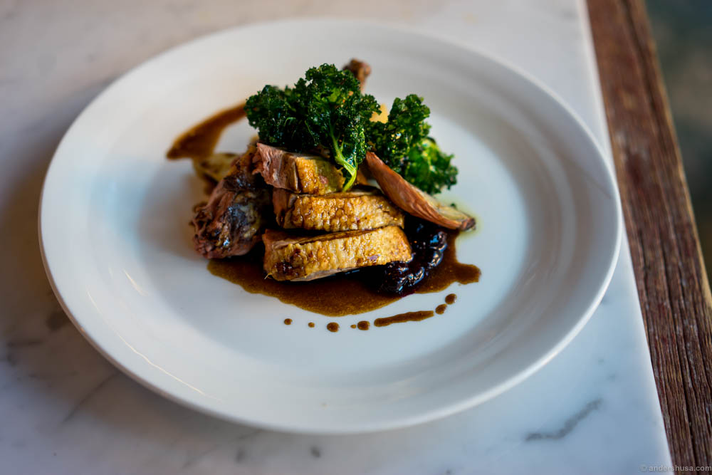 Rotisserie duck with celeriac puree, baked shallots, crispy kale and a redwine sauce with black currants and Lakrids by Johan Bülow