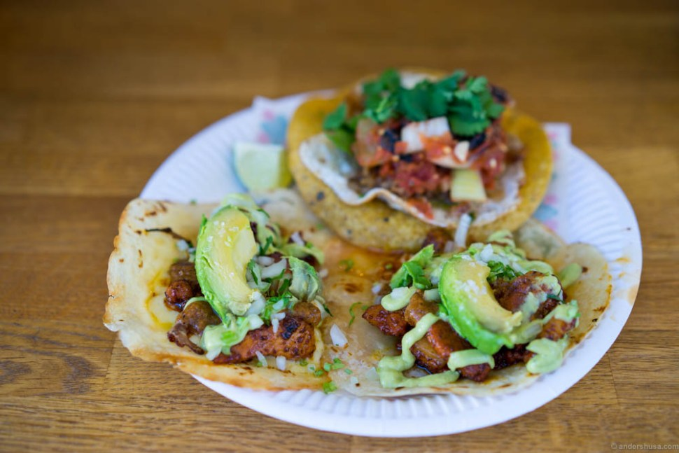 """Two """"gringas"""" in the front – flour tortillas with two months aged cheese and al pastor pork. One tostada with a fried egg in the back."""