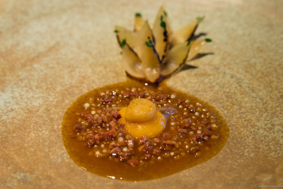 """Charred onions and quail egg cooked in bone marrow, pieces of aged """"fenalår"""" (salted, dried and cured leg of lamb) and an onion vinaigrette with lemon thyme."""