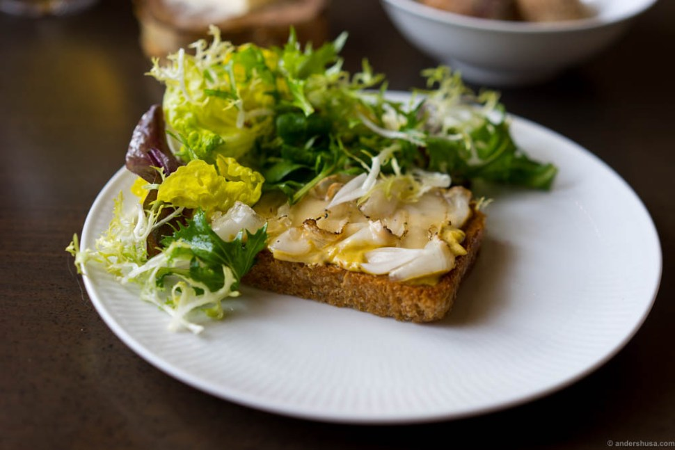 Fried toast with smoked mussel emulsion, lardo, and lettuce.