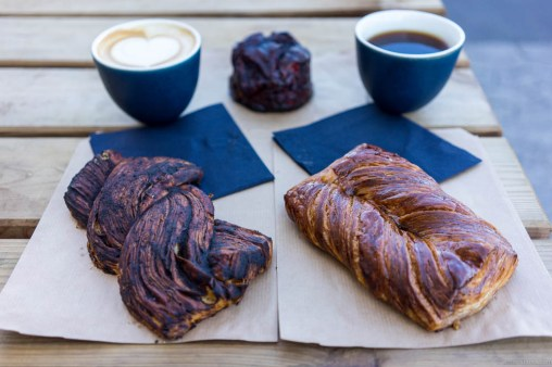 Breakfast pastries at 108 – beef garum twist on the right and rose hip glazed Danish to the left