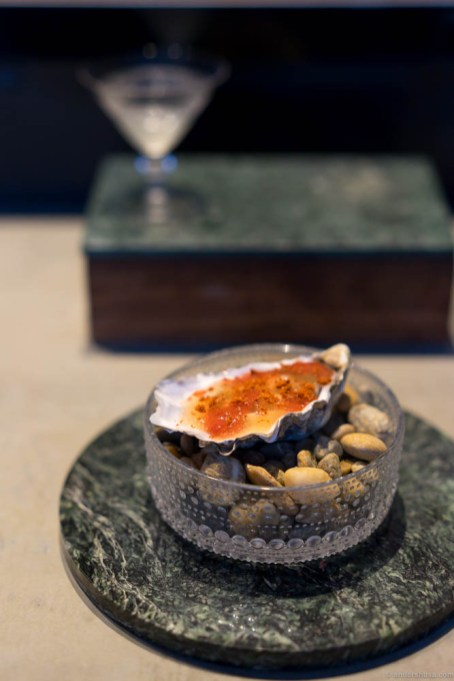 Normandy oysters, blanched for 10 seconds, tomato water gel, tomato meat and tomato powder