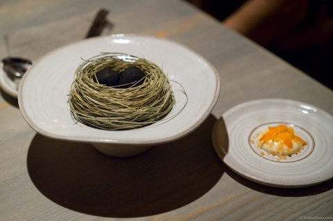 A small egg coated in sheep shit ash, sauce made from dried trout and pickled marigold