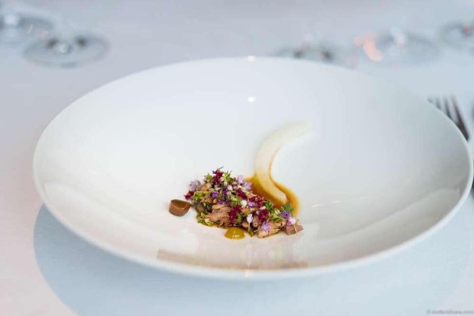 "Grilled pork on the ""bone,"" pickled pine & blackcurrant leaves"