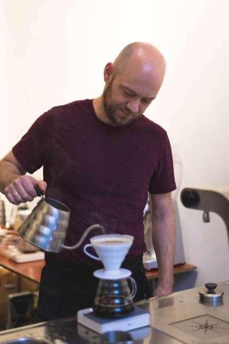 Oliver Hanken brewing some Ethiopian V60 coffee for me