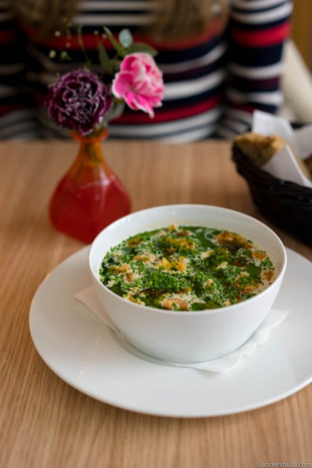 The fish soup contains cod & salmon, fresh shrimps, root vegetables, bread crisps, parsley & chives oil