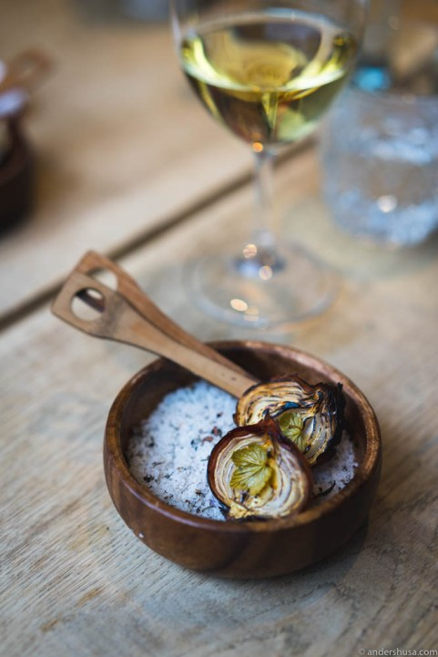 Salt baked onions with black currant shoots and spruce vinegar