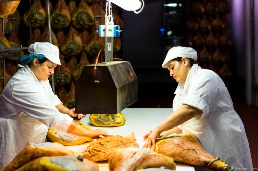 These ladies spend all day covering the exposed part of the ham with pig fat