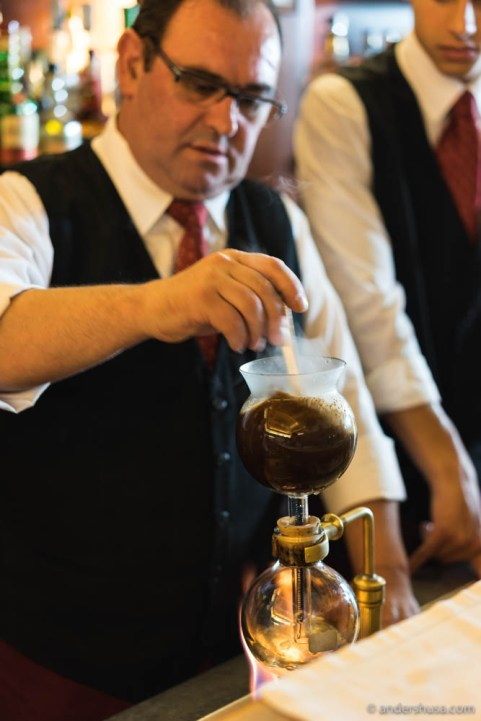 Our waiter prepares the siphon coffee