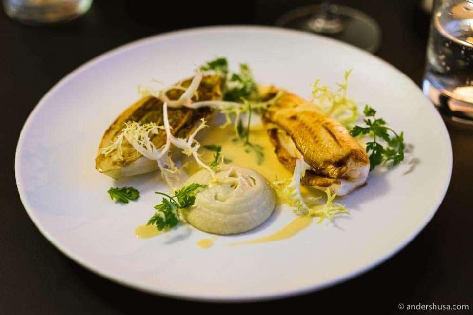 Lemon sole with soufflé of langoustine, grilled salad & artichoke emulsion.
